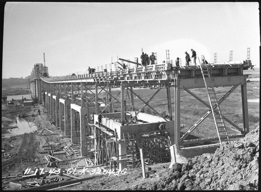 Workers raise the existing Eggners Ferry Bridge in this photo from November 1944 to make way for Kentucky Lake.