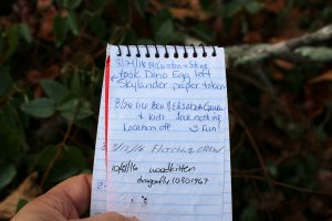 The log book from a geocache in Ivy Cemetery in Calloway County.